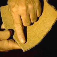 In this photo taken on Sunday, Oct. 26, 2008, Archeologist Yossi Garfinkel displays a ceramic shard bearing Hebrew inscription at the Hebrew University in Jerusalem. Garfinkel says the ceramic shard containing five lines of faded characters written 3,000 years ago at the time of the Old Testament's King David, was found in the ruins of an ancient fortified town south of Jerusalem and is the oldest Hebrew inscription ever discovered, according to Garfinkel. (AP Photo/Sebastian Scheiner)